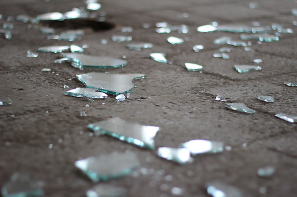 Shattered glass on a stone floor.jpg