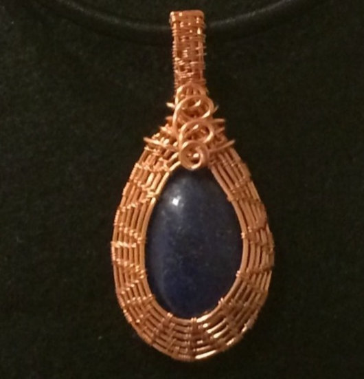 Lapis Lazuli wrapped in woven copper wire
