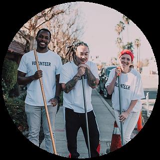 Group of 3 volunteers wearing matching shirts