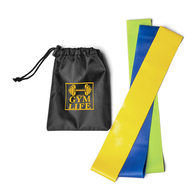fitness resistance bands next to carrier bag with logo