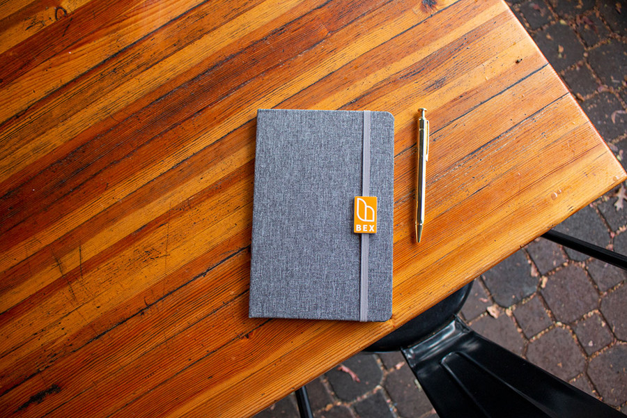 Journal and pen on an outdoor wood table