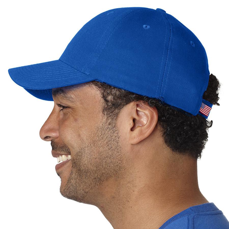 profile view of man wearing blue bayside cap