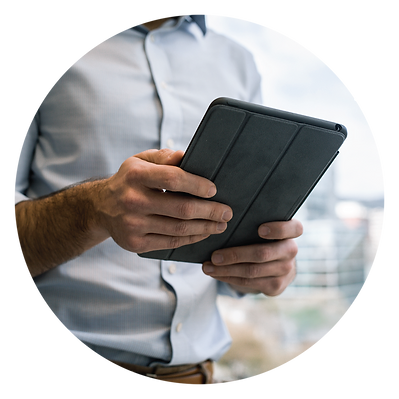 man in business clothes holds a tablet