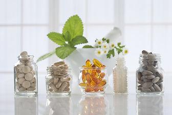 herbal vitamins on white background.jpg