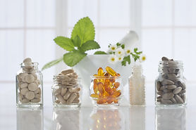 herbal vitamins on white background.jpg
