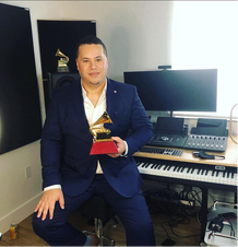 """On 19 November 2020, Dr. José Valentino Ruiz won his second GRAMMY® Award for the category of Best Classical Contemporary Composition as a composer/flutist alongside co-composer/pianist, Carlos Fernando López for their composition """"Sacre."""""""