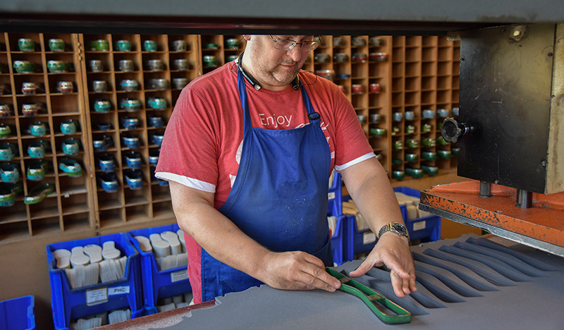 Michael Dethman stamps out parts for Danner boots.