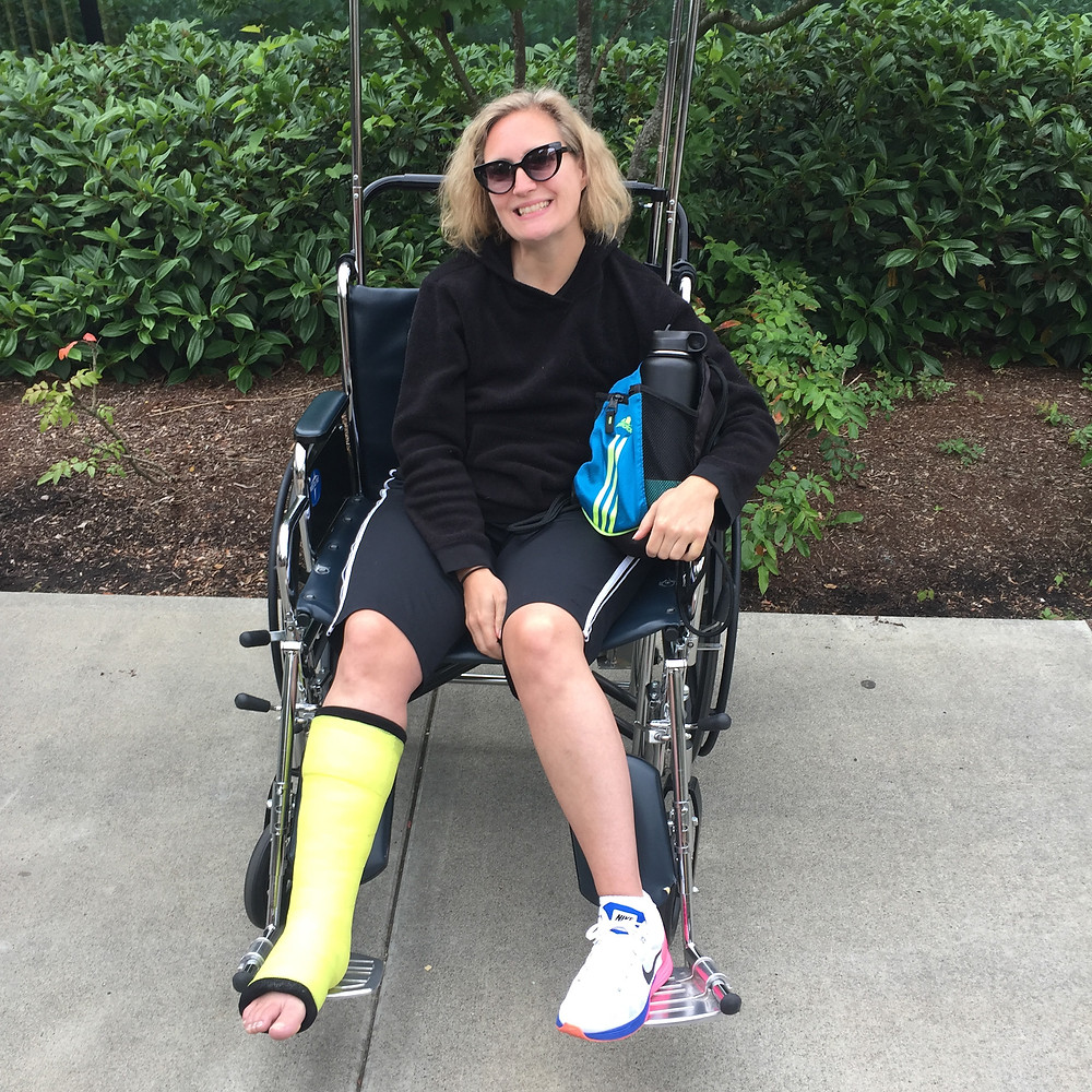 Tiffini sits in a wheelchair after getting her cast for a ruptured Achilles tendon.