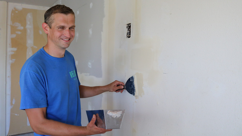 Mason works with the Relay Building Maintenance team to update one of the Relay affordable housing offices.