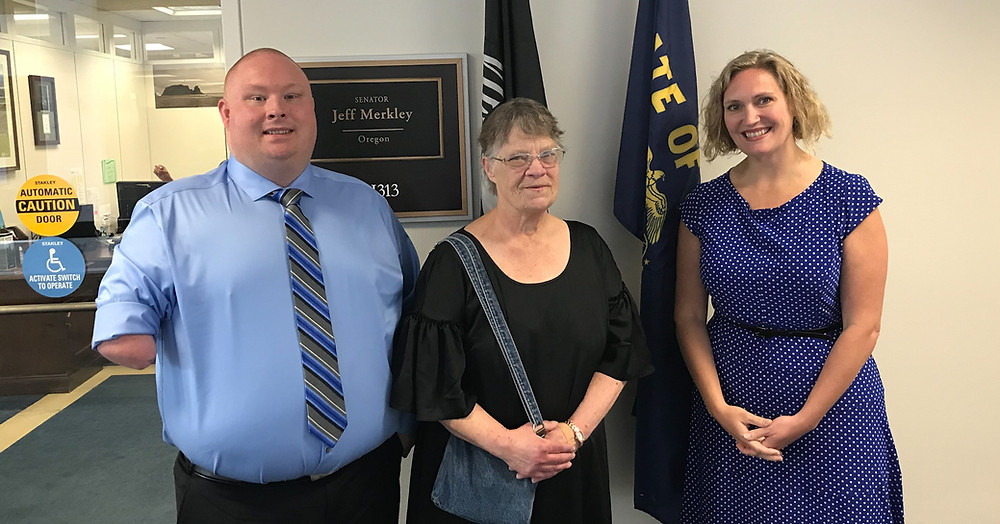 Michael Best, his mother, and Tiffini Mueller pose for a photo while at the SourceAmerica Grassroots Advocacy Conference in Washington, D.C., in June 2019.