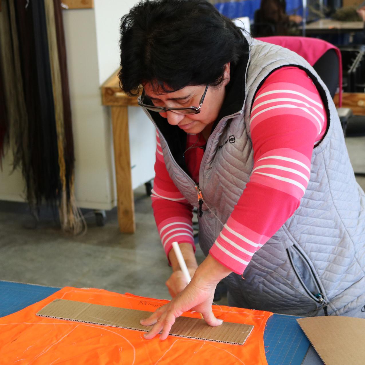 Relay Team Member Measures Fabric