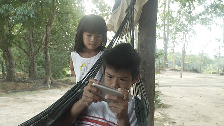 Boy with phone and little girl.jpg