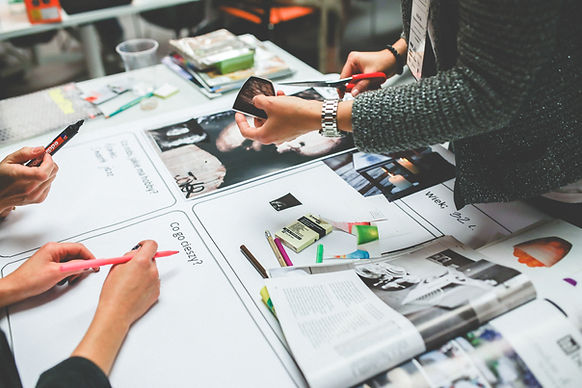 designer hands developing a web design chart flow