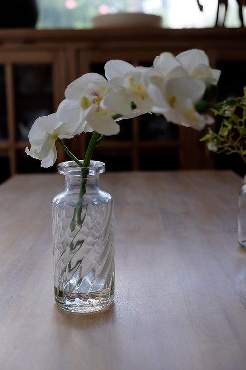 Botellita de vidrio con orquídea