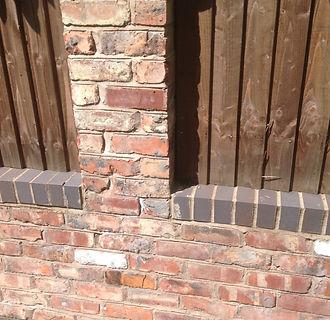 reclaimed brick pillar with blues.jpg