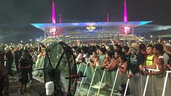 Big Black Misting Fan Cooling the Crowd