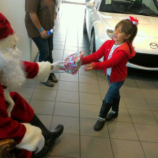 Santa Giving Gifts.jpg
