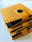 Gold fire hose wallet