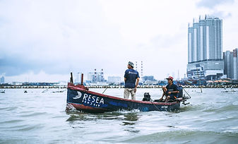 Fishermen-sailing-out-to-sea-to-collect-