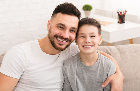 portrait-of-cheerful-dad-and-son-embraci