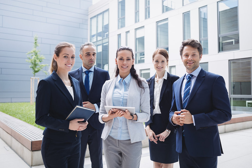 businesspeople-standing-outside-office-b