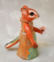 small ceramic chipmunk figurine with pretty dress and rose