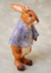 ceramic rabbit character figure with denim shawl
