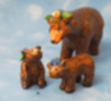 ceramic bear family figurines with glass flower head dresses