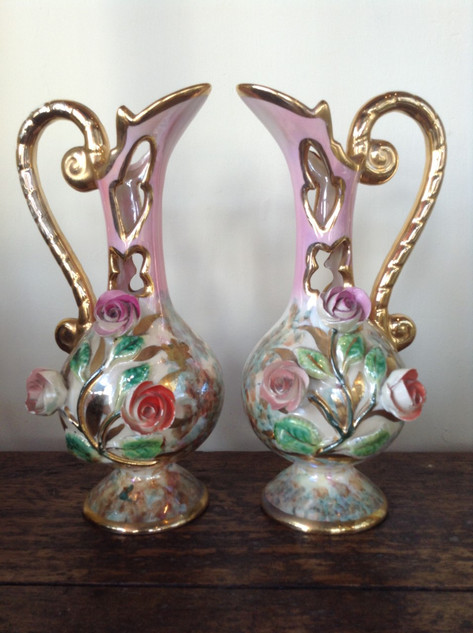 Pair of glazed vases £48