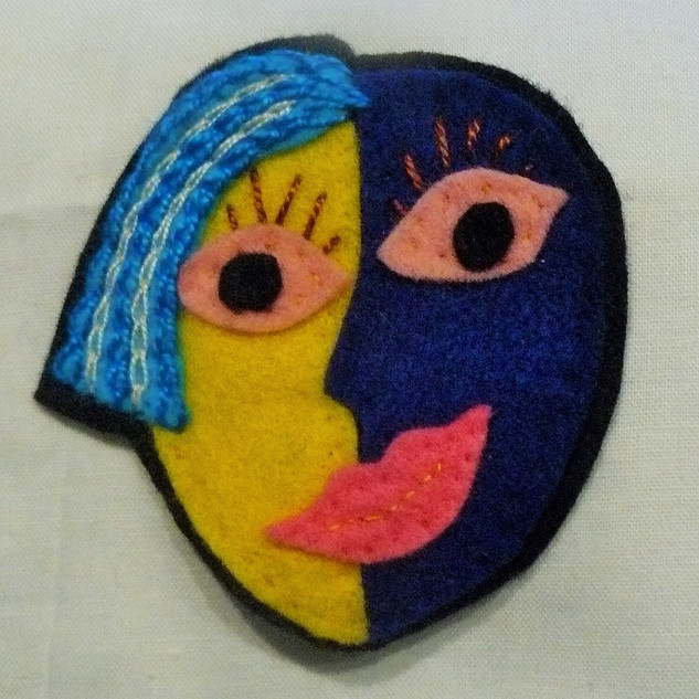 Felt face collage - wearable art