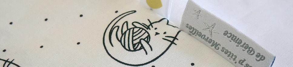 Créations pour bébé en noir et blanc motifs chat et pois
