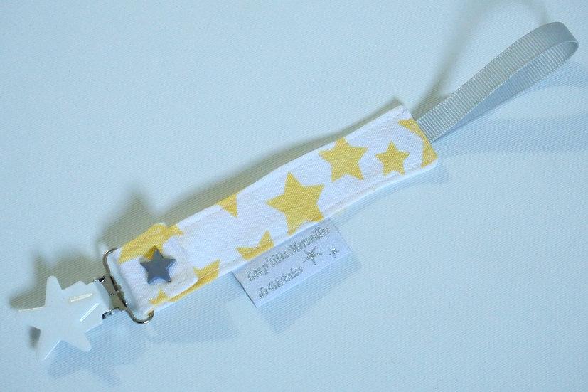 Attache tétine étoiles jaunes fond blanc