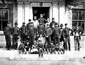 1875 Photographic staff and children