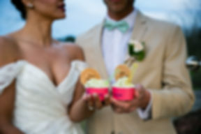 Bride and Groom holding cups of gelato.