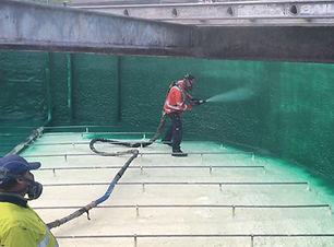 Polyurea over Sprayfoam in Concrete Tank.jpg