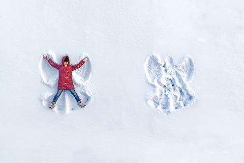 The girl on a snow angel shows.jpg