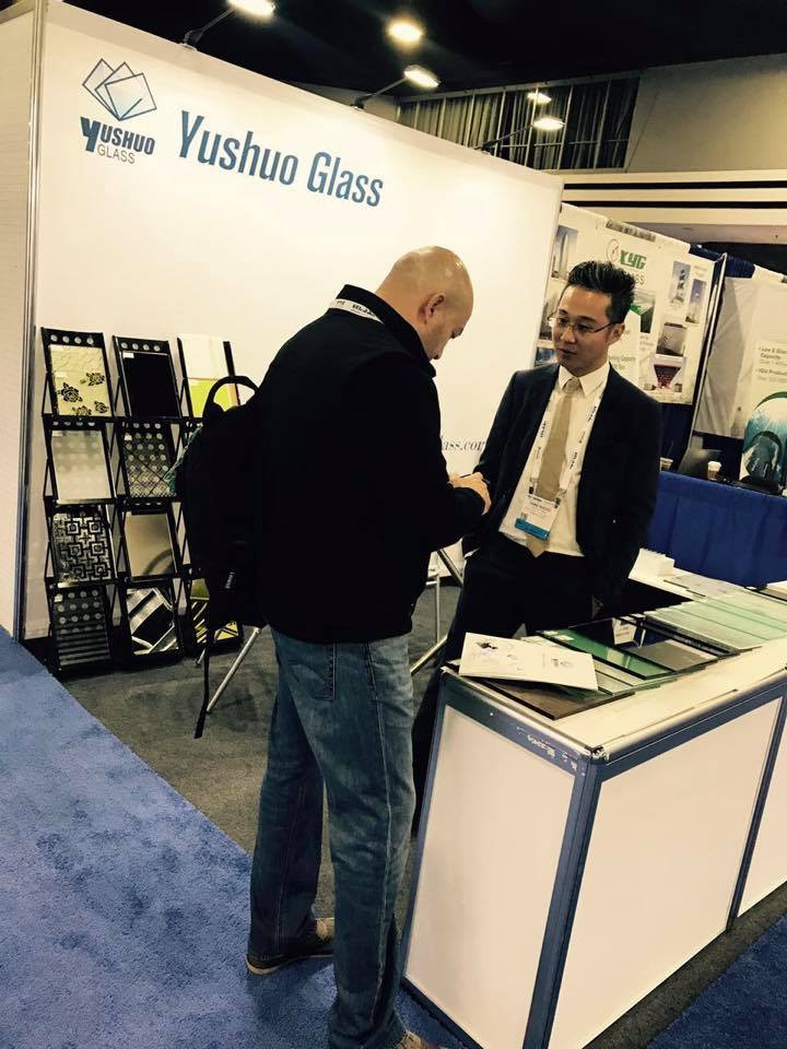 Mr. Aaron Tang personally attending customers on Glass Build Exhibition