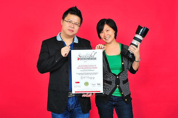 Lisa Lum and Dean Choo of The Colourful Faces Studio receiving Successful Entrepreneur Award 2012