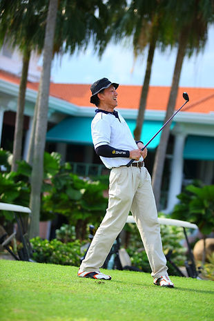 golf tee off action shot
