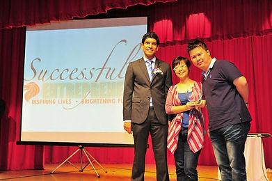 Lisa Lum and Dean Choo receiving award