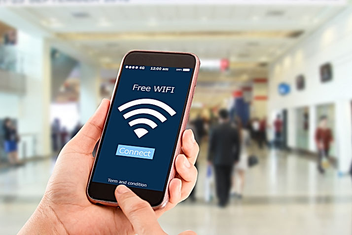 Free wi-fi concept.Hands holding mobile