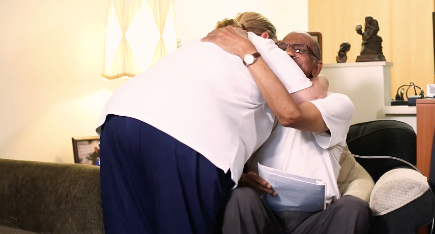 A woman embraces a friends after a death of a loved one