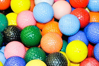 Close up of a pile of multi-colored golf