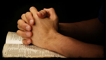 praying-hands-on-scripture.jpg