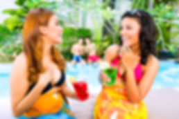Two Women at Pool - Planning Your Vacation