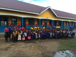 Students Pose infront of Classroom Block
