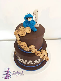 Cookie Monster on his Cake covered in Cookies ready for him to eat! a Cute 1st Birthday Cake