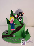 As a girl closes her eyes as he husband rides down the rocky mountain on his pushbike, all captured in cake.  Pushbike themed Cake