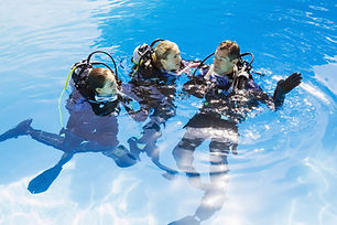 3 scuba divers above water