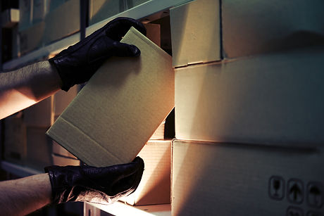 Thief hands with gloves steal a box of g